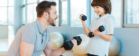 Parent helping untrained child with strength training.