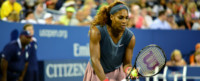 Serena Williams getting ready to hit tennis ball during match
