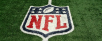NFL Symbol painted on top of football field.