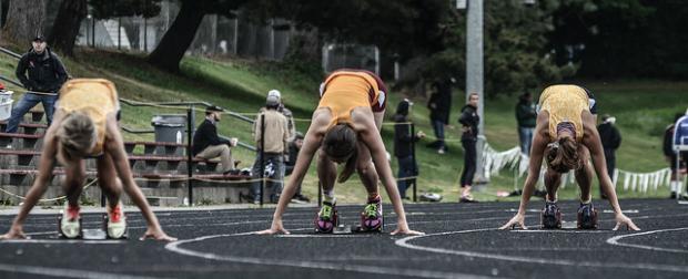 Female athletes training for track meet.
