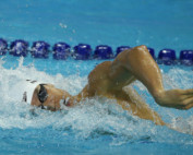 Athlete swimming during tournament.
