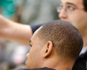 Coach instructing sports athlete.