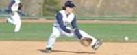 High school baseball player fielding the ball