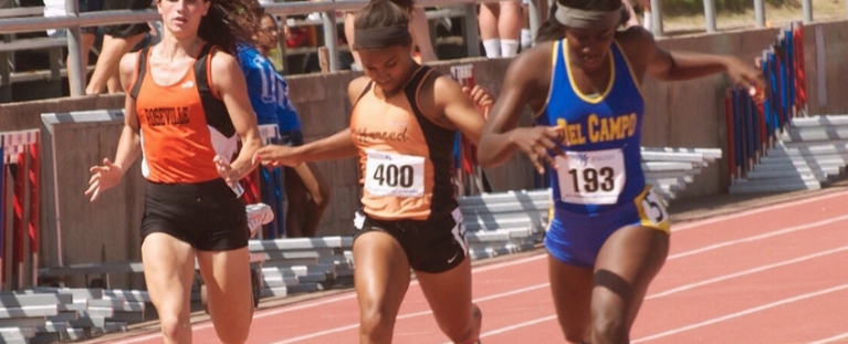 3 track runners crossing the finish line at a race displaying linear speed