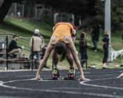 Female athletes running track.