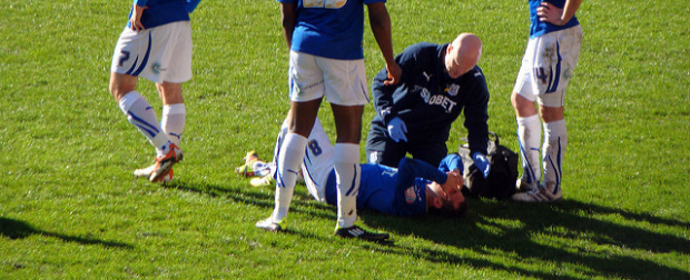 Youth soccer player injured on field.