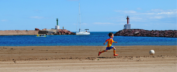 Athlete practicing sport on beach while on vacation.