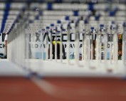 Athlete about to start hurdles match.